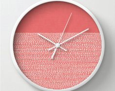 Coral salmon colored wall clock.
