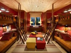 Fun but chic, this ski dorm from the HGTV Dream Home 2011 is punctuated by tomato-red walls, colorful furnishings and a knotty-pine ceiling. Reminiscent of a ski lodge, this bunk room can easily accommodate a multitude of overnight guests.
