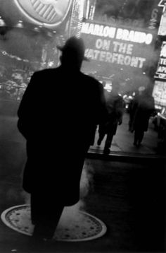 Louis Stettner: Times Square at night, 1954 (with On the Waterfront playing in the cinema).  #NewYorkNewYork