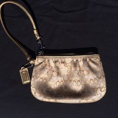 COACH Wristlet - Gold COACH Wristlet - Gold. Great condition, barely used. Coach Bags Clutches & Wristlets