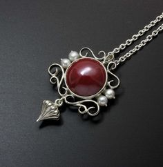 The red cabochon is patinaed copper processed with Japanese traditional technique called Hido. Kazuhiko Ichikawa