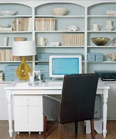 Home office in living room/study - A cleverly arranged bookcase can be as pretty as a window view. Online Interior Design Services, Home Office Space, Office Workspace, Office Shelf, Office Lamp, Study Office, Home Office Organization, Organizing Ideas, Office Storage