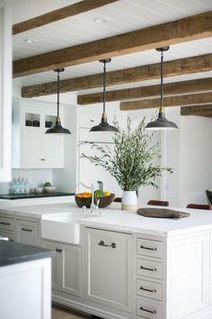 White Kitchen with Wood Beams and Farmhouse Pendants Kitchen Island Lighting, Kitchen Lighting Fixtures, Kitchen Pendant Lighting, Pendant Lights, Light Fixtures, Industrial Lighting, Rustic Lighting, Modern Lighting, Kitchen Lighting Over Table