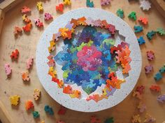 Flower Mandala puzzle by Chris Yates Studios - showing one of the lower levels of the puzzle - there are several in decreasing sizes and different shapes! Beautiful work!