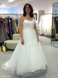 """Kalene was drawn to Alfred Angelo Style 2452 because of the sweetheart neckline. """"You can't see it in the pictures, but the skirt just sparkles underneath the top layer of tulle. It caught the light so beautifully and I know it would look great outside in the sunlight."""""""