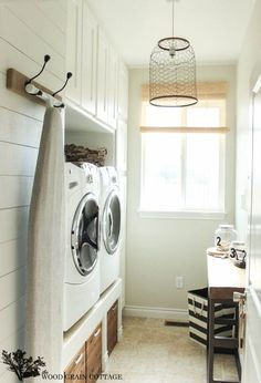 the wood grain cottage-laundry/mud rooms - shiplap paneling, lighting, hooks,tiled floors, white...