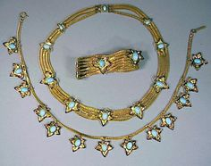 Schiaparelli Gold Star Suite 1940s Two necklaces and bracelet of gilt chains with pendant stars, marked.  Sold for $950