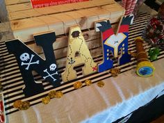 First Birthday party. Jake the neverland pirates theme. Custom painted wooden initials