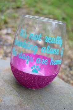 Do you ever feel lonely drinking a glass, er, a bottle of wine by yourself? Get ready to perk up with this witty wine glass that will make your nights in with your dog seem a little less lonesome. Wine glass is a 21 ounce glass that can hold your favorite drink. It is dipped in glitter and sealed twice over so glitter wont flake off on your hands. Lettering is all-weather vinyl (same vinyl used for car decals). Vinyl comes in over 40 colors, and can be customized to your taste. CARE…