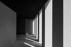 The eternal rhythm of time expressed in light and shadow. Collonade of the Youth Hostel in Antwerp by vincent van Duysen.