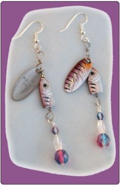 http://diginanchors.com/EarringsAlure_DanglePurpleSpinner - Dangling earrings made with beautifully purple finished, high quality lures.  Added to each fishing lure is sparkling purple beads and crystals matching the color of the lure.The unique earring are 3 and 1/4 inches long.The earrings are hung on silver plated earwires made with surgical stainless steel.