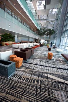 Brintons illustrated its ability to deliver massive projects on time when it recently supplied its hard-wearing Axminster carpet to the new and expansive T3 building at Changi Airport in Singapore - Image - Design Build Network