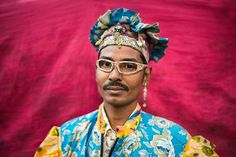"""This is Md. Sabuj -a local betel leaf seller near Banani, Dhaka. I asked him, 'why such outfit??'  - """"This is marketing strategy"""", he replied.  Well he was right indeed.  Photographer: Avishek Bhattacharjee"""