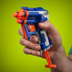 NERF Triad Elite Mini Blaster shoots up to 75 feet! (A staple at the ChoreMonster offices) Kids Gardening Gloves, Minis, Pistola Nerf, Cool Nerf Guns, Nerf Toys, Gadget World, All Kids, Cool Tech, Toys R Us