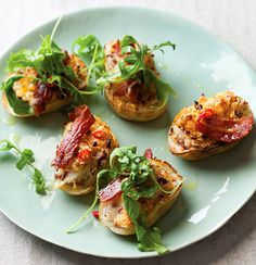 Potato skins stuffed with bacon and rocket are super easy and great with a cold beer on a weekend afternoon. Use mild gouda or sharper cheddar and top with rocket and chillies. Yum!