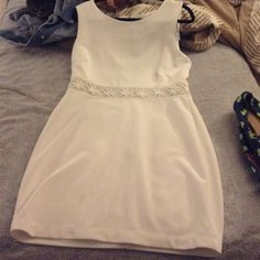 White dress with floral detail Super cute white dress with floral detailing. The floral detailing has a mesh behind it! Worn once Bisou Bisou Dresses