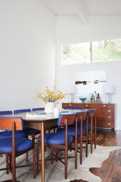 Royal blue upholstered dining chairs to brighten up a wooden dining table set | bright-dining-room-1
