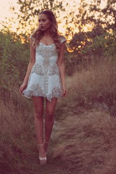 White cap sleeve dress with intricate beading. So boho and pretty.