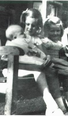 Baby Diana Spencer being held by her sister