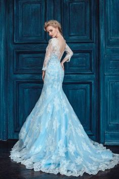 can anyone help me locate an elsa from disneys frozen inspired wedding dress similar to the one pictured blue with lace are the main criteria