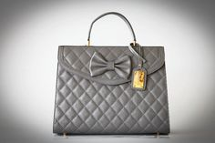 Classic Chic. Genuine leather with gold plated, handmade in the Middle East. Love classic! Available on:  http://www.ananasa.com/