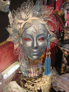 Venetian mask. I like the arc of flowers at the top of the mask. The eyebrows and lips freak me out.