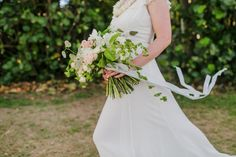 Organic, Romantic, DIY Bouquet with ribbon, created by the bride. Taken at Maluaka Beach, Makena by Caitlin Cathey Photography - Maui, Hawaii