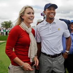 United States team player Tiger Woods, right, smiles with girlfriend Lindsey Vonn