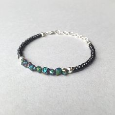 Everyday Style- this delicate bracelet highlights a swath of rough Rainbow Hematite beads, complimented with Silver Pyrites & faceted Black Spinels. Complete with sterling silver findings & chain links.                ( $28)  #beadedbracelet #stackingbracelet #gemstonebracelet