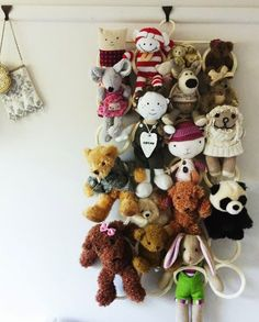 brilliant use of Ikea komplement scarf organizer for helping get stuffed animals into order. http://www.hellobee.com/2014/02/25/ikea-for-kids/