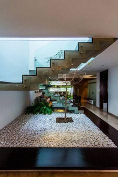 Papelillo: Pasillo, hall y escaleras de estilo translation missing: mx.style.pasillo-hall-y-escaleras.moderno por aaestudio