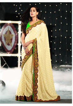 Beautiful cream plain with golden embroidery border design #designer #saree
