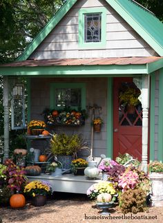Fall around the Potting Shed with a harvest of pumpkins, mums, gourds, and goldenrod.
