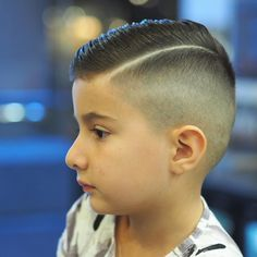 Little Rokkman Rokkstar  Hope you all enjoy this amazing Sunday.  #barber #fade #scissorsalute #lineup #texture #menshair #collinsstreet #dapper #bespoke #design #fashion #mensgrooming #barbering #beard #thebarberpost #nastybarbers #barbershopconnect @thebarberpost @barbershopconnect @internationalbarbers by rokkmanbarbers