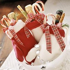Mitten Bags ~ If you want to send party guests home with a few goodies, skip the conventional paper gift bag for something more creative, such as these fuzzy mitten bags. Grouped in a container, these also make a nice table display for your party.