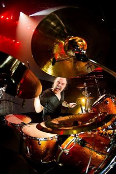 Lars Ulrich/Metallica..... The drumming on And Justice is by far one of the greatest displays of raw emotion conveyed by way of percussion ever.
