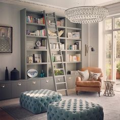 Stunning built-ins with book ladder. Tres chic.
