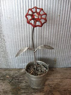 Metal Flower...Take An Old Milk Bucket, Nails, & Water Faucet Handle, Scrap Metal For Leaves And Stem... And You Have A Pretty Flower That Will Get Prettier As It Ages