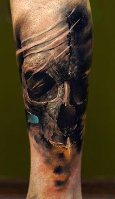 Dark Skull Tattoo, I don't usually care for skulls but this one looks cool. It almost looks like tree bark!