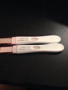 positive pregnancy test in black girl hand