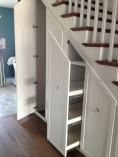 Our Town Plans - 2013 Coastal Living Showhouse - Under stair storage at its best! Walk-in and pull-out storage makes use of every inch of space.