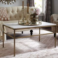"Ethel Marble Top Coffee Table, reg 549.95, sale $399.98 -- ""Polished, white marble with subtle hints of gray sits atop a hand-forged, solid wrought iron frame that has been hand-hammered and given an antique brass finish."""