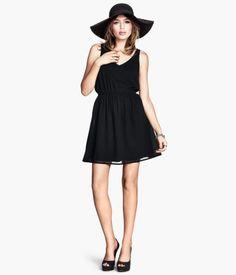 Short, sleeveless dress in sheer woven fabric. Elasticized waist seam and lined skirt.