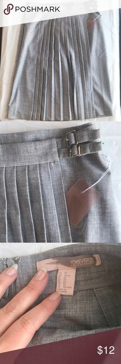 """Forever 21 NWT gray kilt skirt Forever 21 skirt, NWT and no issues. Gray. 24.75"""" long. 16"""" waist (flat). Fabric has plenty of give.   Unless otherwise noted, items I'm selling have been worn and will show signs of typical wear. I will note any issues. All items ship promptly from my non-smoking, clean, cat-friendly home. Forever 21 Skirts"""