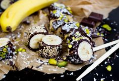 This banana sushi is covered in chocolate and topped with pistachios, coconut flakes, chia and sesame seeds. The recipe is super easy. No rolling required!