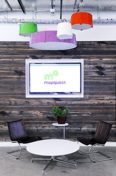 reclaimed wood wall with tv (Mapquest office)