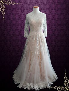 Gorgeous blush colored lace wedding dress made with ivory lace and soft tulle. Photoed in a peachy blush color. This dress can also be made in all ivory or white. Working Time: 8-10 weeks Rush Order p