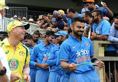 Virat Kohli and David Warner enjoy a light moment before start of 1st ODI play in Perth during India's tour to Australia on 12/01/2016.