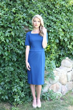 Harper, a modest blue dress, available in blue, red, and navy.