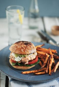 {Salmon burger and sweet potato fries.}